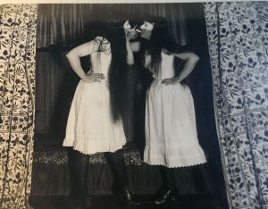 An early photograph by Alice Austen shows her playful style. In the photo, she and a neighbor pretend to light cigarettes in their undergarments. (Courtesy of the Alice Austen Museum)