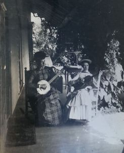 Alice Austen with a friend playing music on the porch of her home, Clear Comfort. (Courtesy of the Alice Austen Museum)